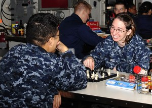 800px-US_Navy_101125-N-0173G-001_Aerographer's_Mate_3rd_Class_Ambre_Witt_and_Airman_Francis_Vincent_play_a_game_of_chess_during_family_style_night_hosted