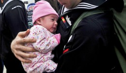 Defense.gov_News_Photo_101101-N-7103C-192_-_U.S._Navy_Petty_Officer_3rd_Class_Matthew_Sandlin_holds_his_newborn_daughter_for_the_first_time_after_being_underway_for_six_months_aboard_the