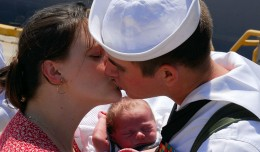 US_Navy_070703-N-1688B-072_A_new_father_aboard_dock_landing_ship_USS_Oak_Hill_(LSD_51)_greets_his_wife_and_baby_after_returning_home_to_Naval_Amphibious_Base_Little_Creek