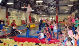 800px-US_Navy_110810-N-CI293-160_Cmdr._Shannon_Tolliver_walks_the_plank_at_the_TNT_Kids_Fitness_and_Gymnastics_Academy
